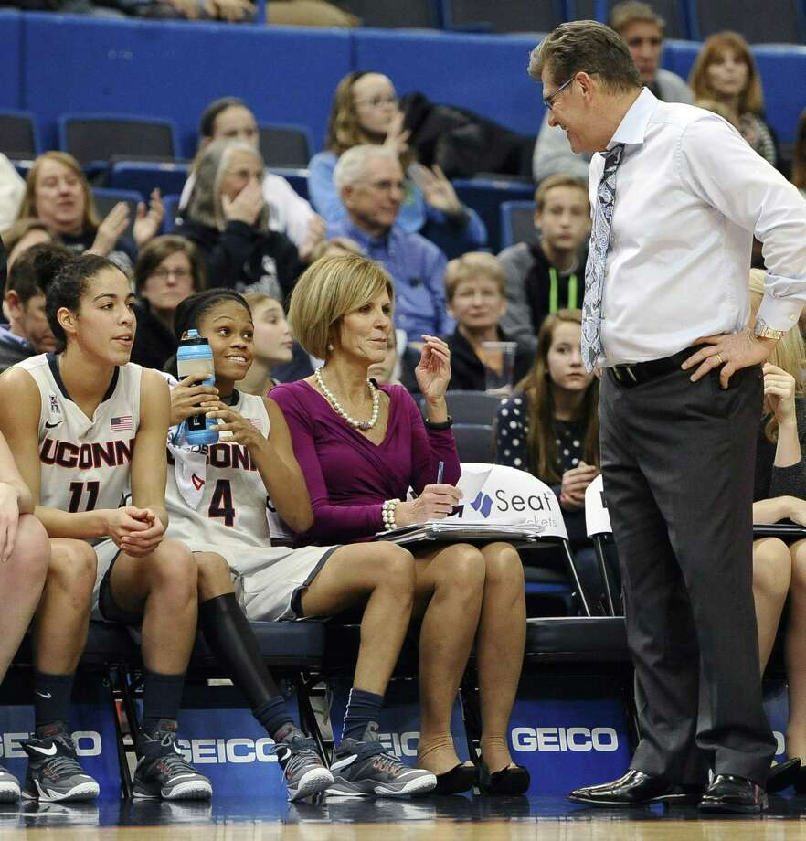 UConn associate head coach Chris Dailey, center, traveled to Texas a day early to scout consensus top-ranked Class of 2016 player Lauren Cox. Photo: Jessica Hill — The Associated Press  / FR125654 AP