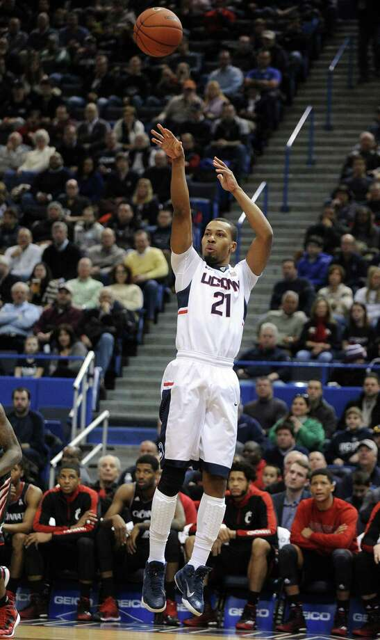 UConn's Omar Calhoun shoots during the first half of the Huskies' 62-56 win over Cincinnati on Saturday at the XL Center in Hartford. Photo: Fred Beckham — The Associated Press  / FR153656 AP
