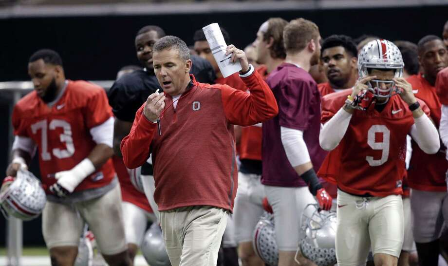 When Urban Meyer took a year off from coaching, he made a trip to Oregon to visit an old friend — Ducks defensive coordinator Nick Aliotti — and to find out how Chip Kelly was running the show in Eugene. Photo: Gerald Herbert — The Associated Press  / AP