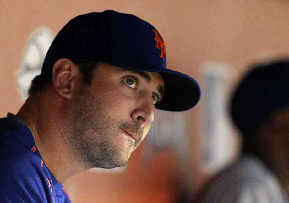 New York Mets starter Matt Harvey watches from the dugout in the eighth inning of Saturday's game against the Marlins in Miami. Photo: Joe Skipper — The Associated Press  / FR171174 AP