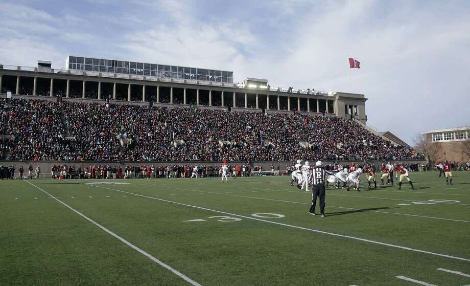 In this Nov. 22, 2014 photo, Harvard and Yale compete at Harvard Stadium in Cambridge, Mass. The U.S. Olympic Committee picked Boston on Thursday as its bid city for the 2024 Summer Games. The city will be presented to the International Olympic Committee for a vote in 2017. Boston's bid enlists the area's 100 colleges and universities — and their existing and envisioned athletic facilities — as potential hosts for Olympic venues. Photo: Stephan Savoia — The Associated Press File Photo  / AP