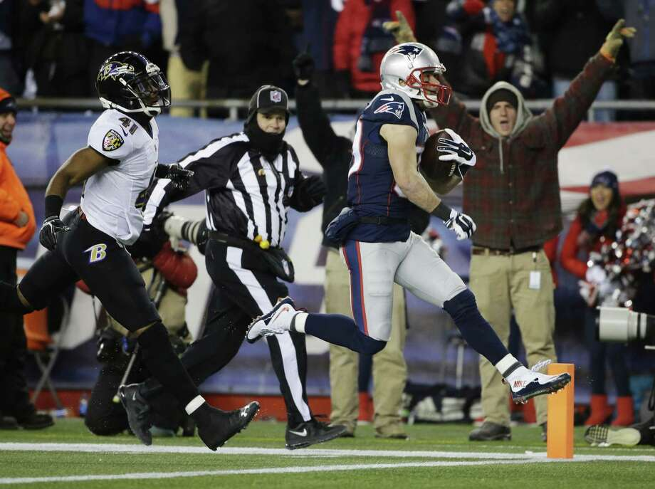 Patriots wide receiver Danny Amendola scores a 51-yard touchdown after catching a pass from Julian Edelman in the second half Saturday. Photo: Steven Senne — The Associated Press  / AP