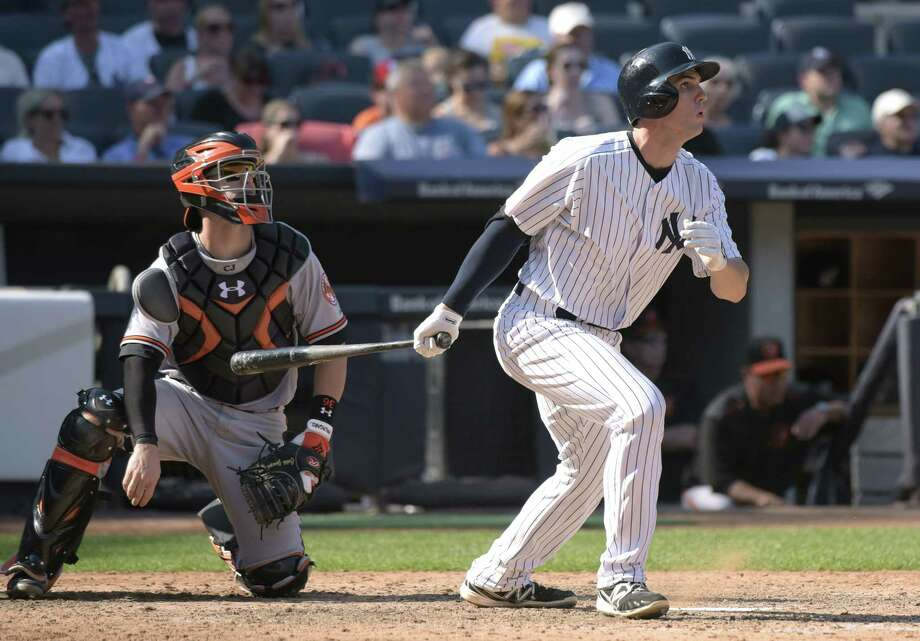 Yankees rookie Greg Bird, right, hits a three-run home run against the Baltimore Orioles in the seventh inning of Monday's game in New York. Photo: Bill Kostroun — The Associated Press  / FR51951 AP