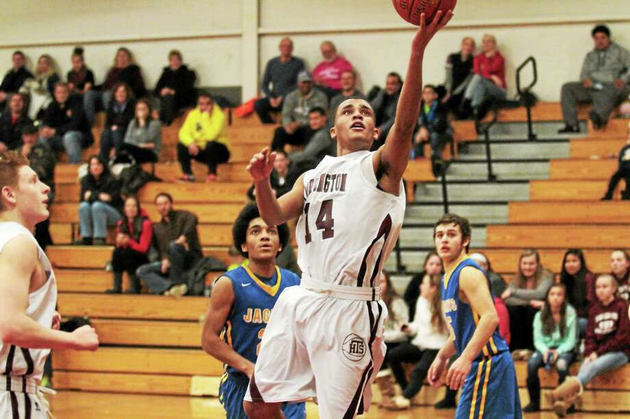 Torrington's David White goes up for a layup. Photo: Marianne Killackey — Special To The Register Citizen  / 2014