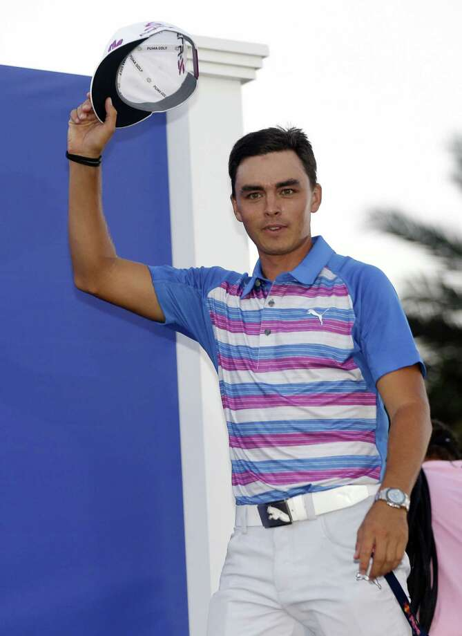 Rickie Fowler celebrates after winning The Players Championship on Sunday. Photo: Lynne Sladky — The Associated Press  / AP