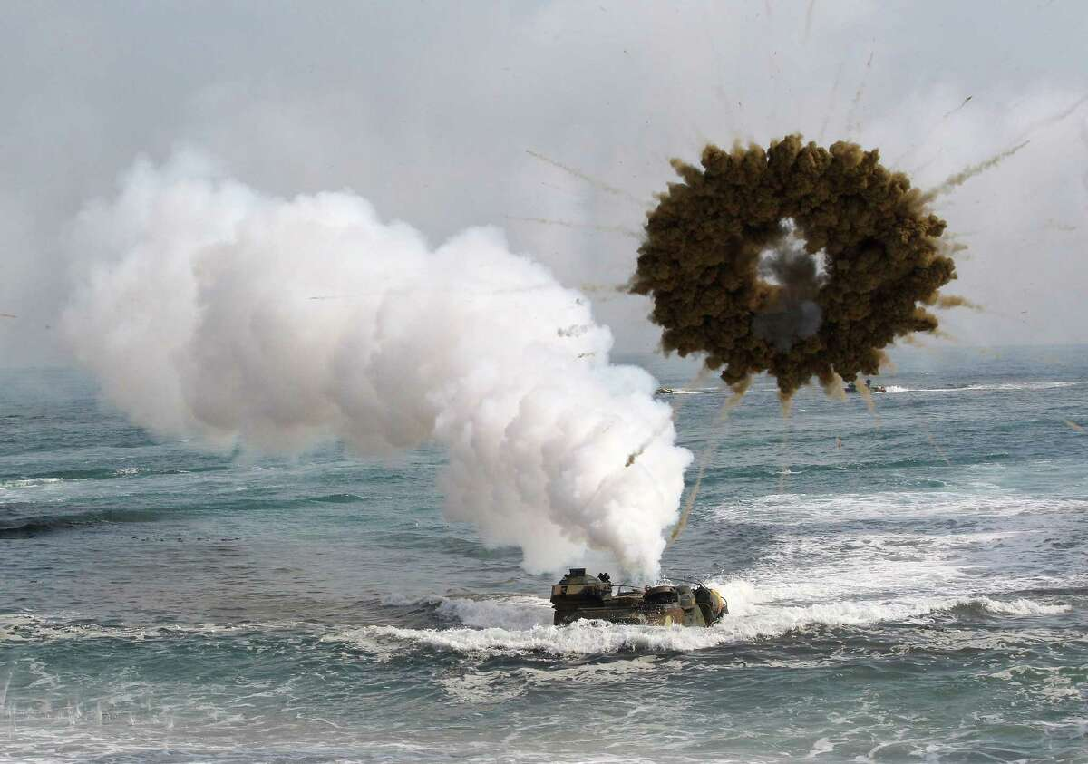 FILE - In this March 31, 2014 file photo, a South Korean marine LVT-7 landing craft sails to shores through a smoke screen during the U.S.-South Korea joint landing exercises, called Ssangyong, part of the Foal Eagle military exercises, in Pohang, South Korea. North Korea has told the United States that itís willing to impose a temporary moratorium on nuclear tests if Washington scraps planned military drills with South Korea this year, the Northís official news agency said Saturday, Jan. 10, 2015. The U.S. has previously refused to cancel military drills with South Korea, even at times of high tension and has said the North must first demonstrate how serious it is about nuclear disarmament before serous talks can resume. (AP Photo/Ahn Young-joon, File)