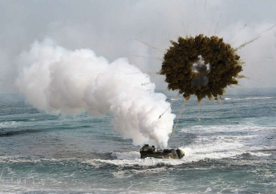 FILE - In this March 31, 2014 file photo, a South Korean marine LVT-7 landing craft sails to shores through a smoke screen during the U.S.-South Korea joint landing exercises, called Ssangyong, part of the Foal Eagle military exercises, in Pohang, South Korea. North Korea has told the United States that itís willing to impose a temporary moratorium on nuclear tests if Washington scraps planned military drills with South Korea this year, the Northís official news agency said Saturday, Jan. 10, 2015. The U.S. has previously refused to cancel military drills with South Korea, even at times of high tension and has said the North must first demonstrate how serious it is about nuclear disarmament before serous talks can resume. (AP Photo/Ahn Young-joon, File) Photo: AP / AP