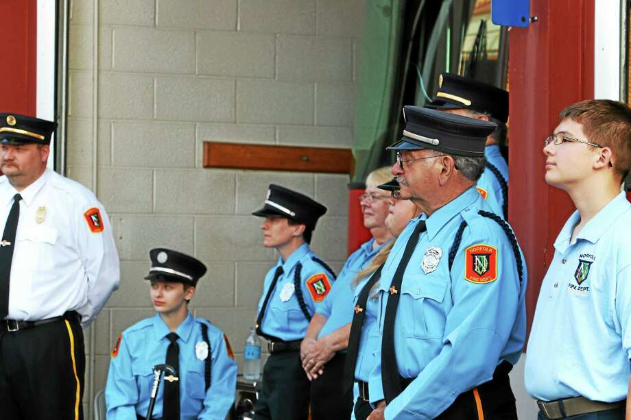 Members of the Norfolk Volunteer Fire Department at the ceremony. Photo: John Fitts — The Register Citizen