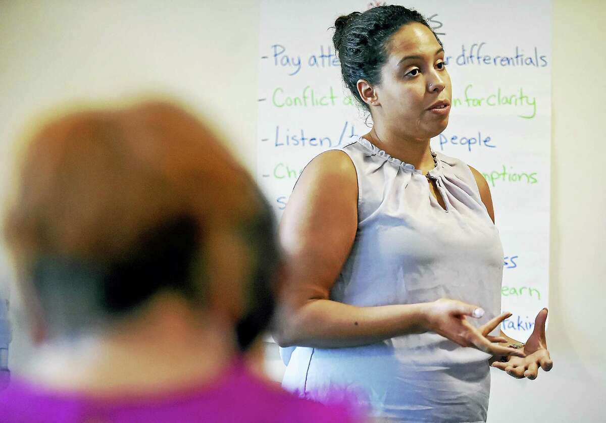 Krystal Ambrozaitis, an anti-human trafficking coordinator at the Salvation Army of Southern New England, speaks Wednesday during a training session held by the Connecticut Coalition to End Homelessness in Hamden.