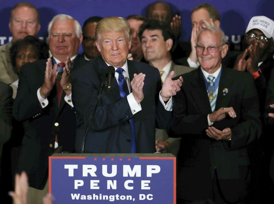 Republican presidential candidate Donald Trump leads the crowd in an applause, recognizing a Gold Star mother in the crowd during a gathering with military leaders and veterans at the new Trump International Hotel in Washington, Friday, Sept. 16, 2016. Photo: AP Photo/Manuel Balce Ceneta   / Copyright 2016 The Associated Press. All rights reserved.