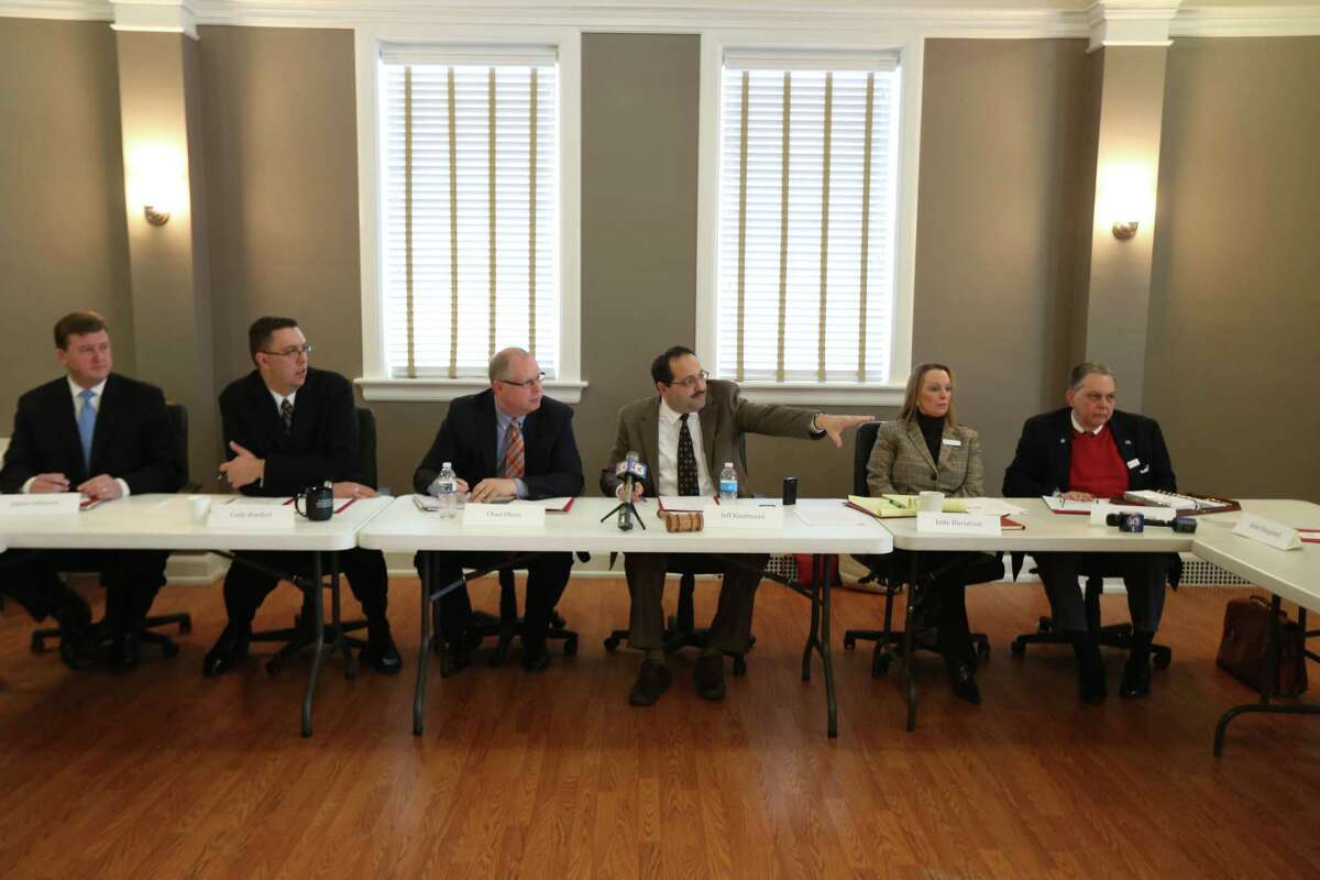 Jeff Kauffmann, third from right, committee chairman of the Republican Party of Iowa gestures while seating alongside leadership of the group as they conduct a vote on the future of their presidential straw poll, Saturday, Jan. 10, 2015, at the party headquarters in Des Moines, Iowa. Despite criticism from some prominent Republicans, the Republican Party of Iowa's central committee unanimously voted Saturday to keep the event going. (AP Photo/The Des Moines Register, Charlie Litchfield)
