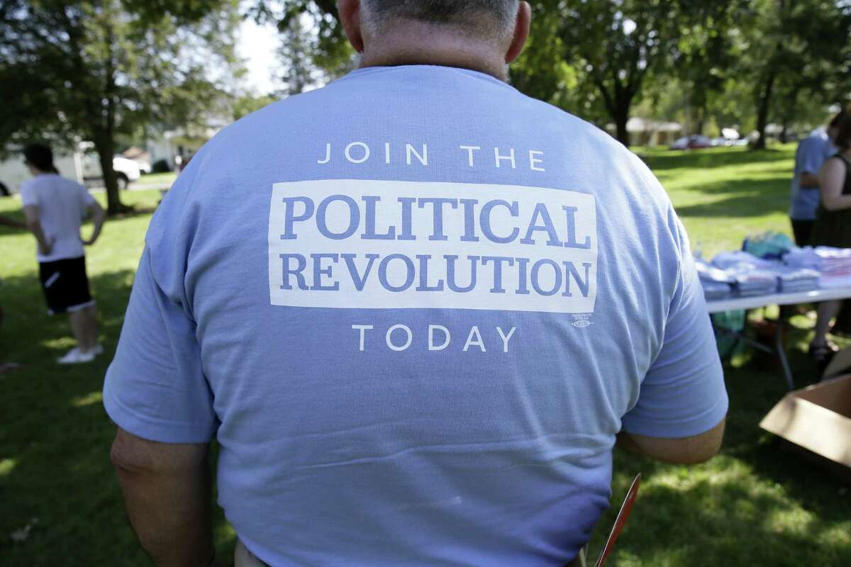 The back of a shirt of a supporter for Democratic presidential candidate, Sen. Bernie Sanders, I-Vt., during a town hall meeting in Grinnell, Iowa.