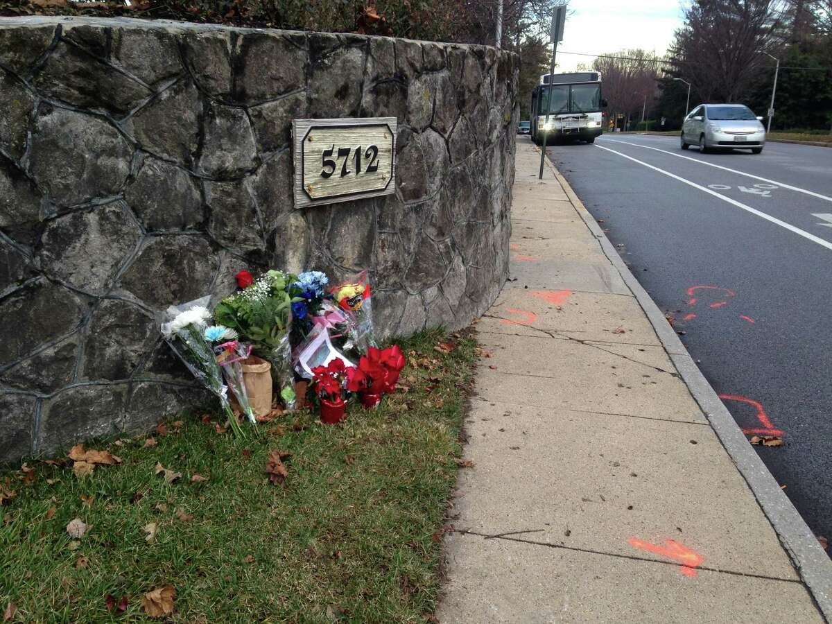 FILE - In this Dec. 29, 2014 file photo, flowers and messages are placed at the scene of a fatal collision between a car and bicyclist along a Baltimore residential street with a bike lane. Marylandís second-highest ranking Episcopal leader and the first female bishop in her diocese was charged with drunken driving and manslaughter after fatally striking a cyclist in late December. Heather Cook, 58, turned herself in to authorities Friday, Jan. 9, 2015, according to her attorney, David Irwin. Online court records show Cookís bail was set at $2.5 million. A trial is scheduled for Feb. 6. (AP Photo/Amanda Kell)