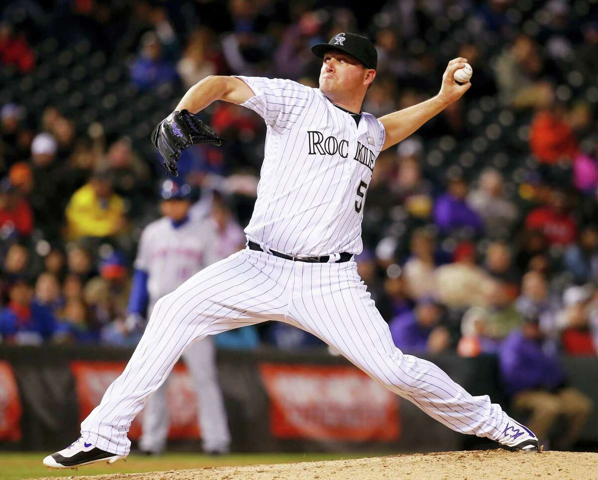 Rockies relief pitcher Jake McGee throws against the Mets during the ninth inning on Saturday in Denver.