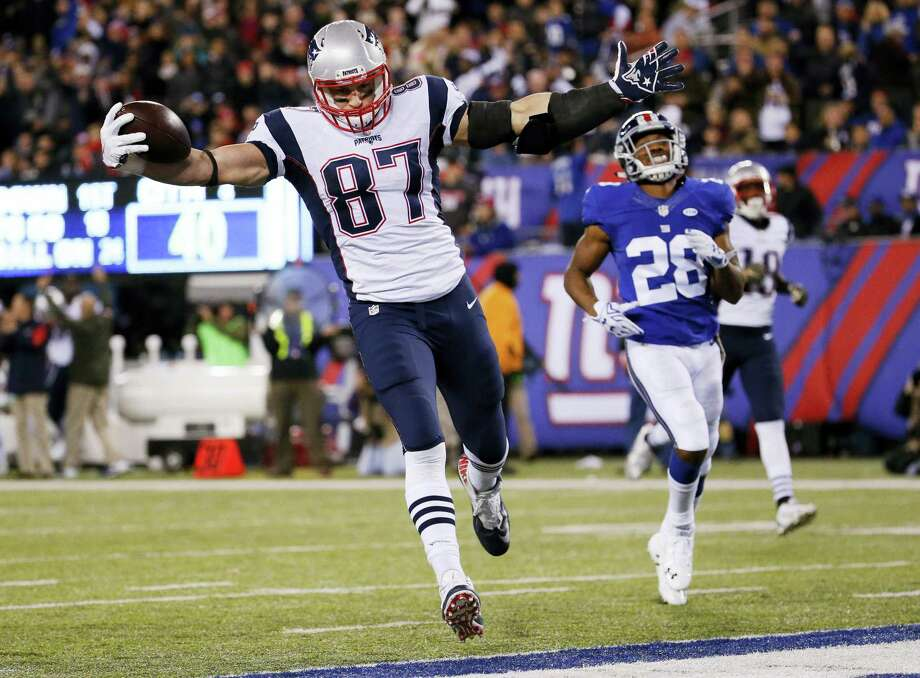 Rob Gronkowski scores a touchdown earlier this season. Gronkowski and the Patriots get an extra week of rest having secured a first-round bye. Photo: The Associated Press File Photo  / AP