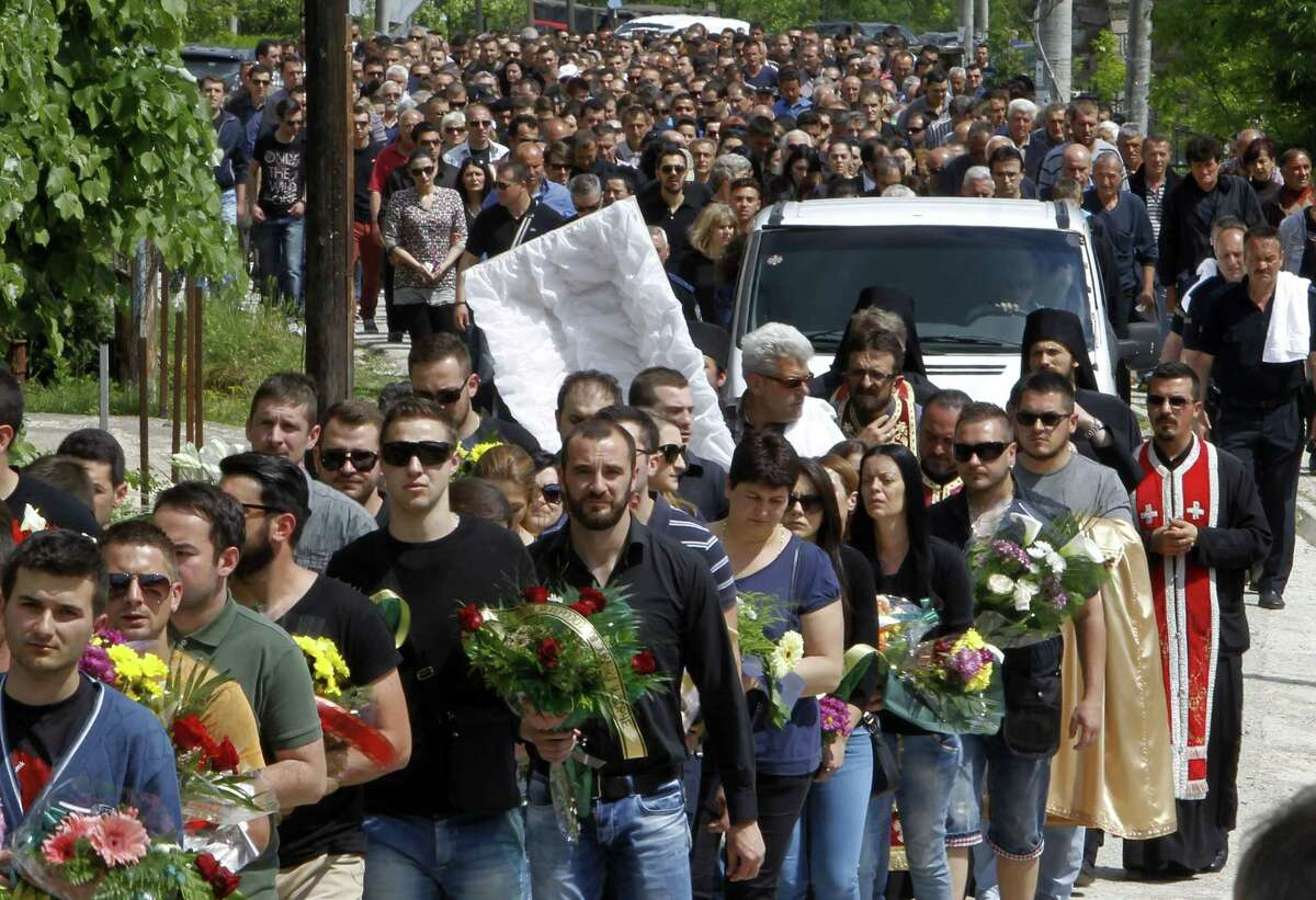 A funeral procession for Macedonian police officer Nenad Serafimovski moves through the village of Zubovci, near Gostivar, in western Macedonia, Sunday, May 10, 2015. Serafimovski is one of the eight police officers who were killed in an exchange of fire between special police forces and an armed group that started in Macedonian northern town of Kumanovo on Saturday. Macedonia's prime minister says the armed group involved in bloody battles with the police this weekend in this northern town had aimed to attack state buildings and public spaces. (AP Photo/Boris Grdanoski)