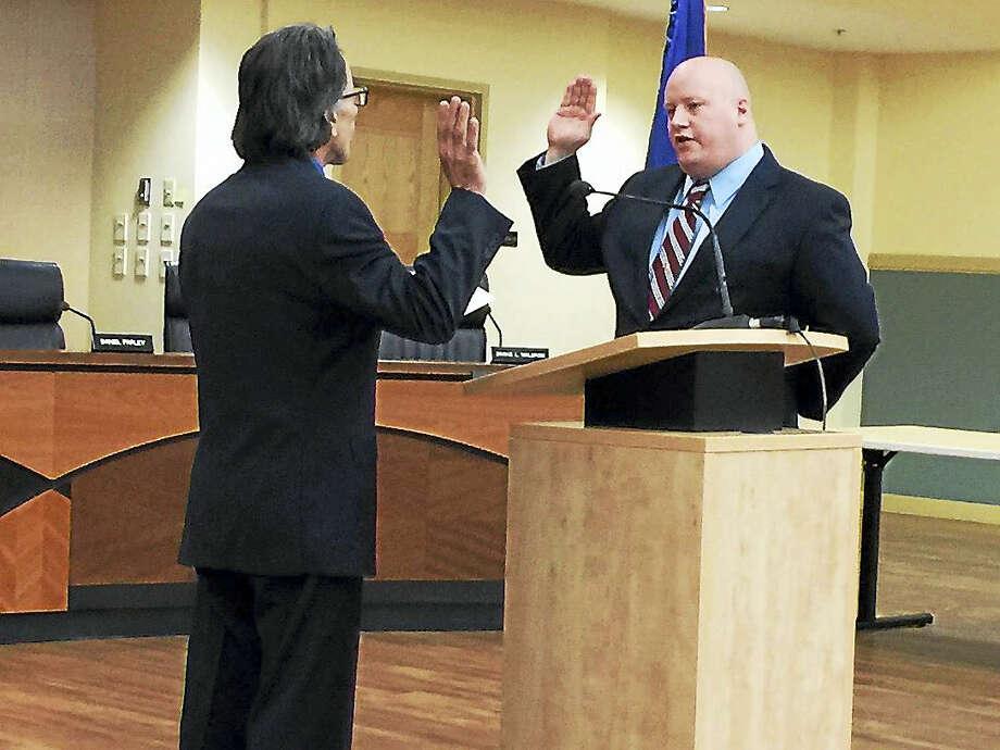 Chris Diorio, as he was sworn into office in December for the Torrington Board of Finance. Photo: BEN LAMBERT — The Register Citizen