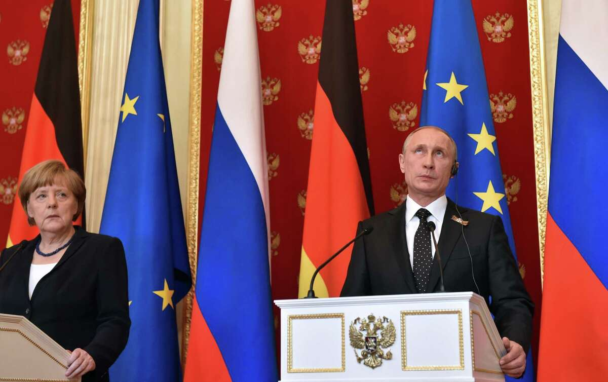 Russian President Vladimir Putin, right, and German Chancellor Angela Merkel attend a joint news conference in the Kremlin in Moscow, Russia, Sunday, May 10, 2015. Angela Merkel has called during a visit to Moscow for Russia to do more to persuade separatists in eastern Ukraine to abide by a cease-fire that has been strained in recent weeks.