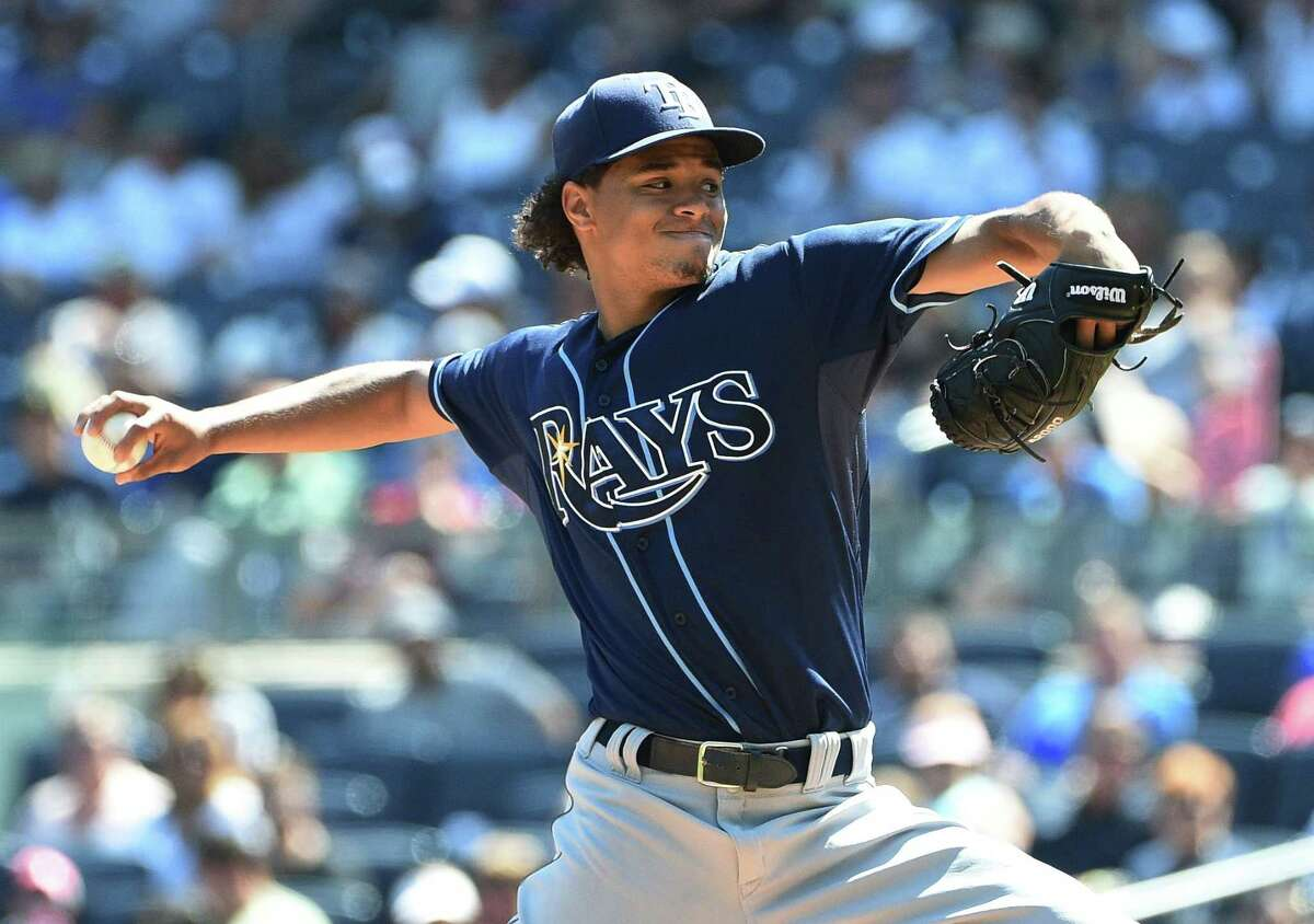 Rays starter Chris Archer delivers a pitch against the Yankees during the first inning on Sunday.