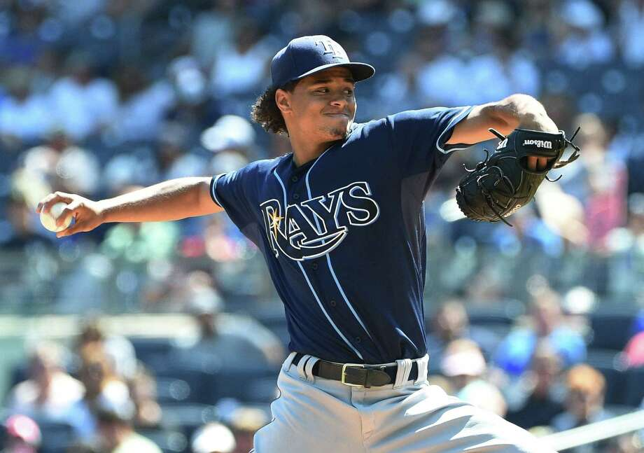 Rays starter Chris Archer delivers a pitch against the Yankees during the first inning on Sunday. Photo: The Associated Press  / Newsday