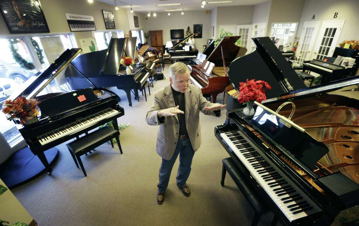 Jim Foster talks about his career at his Foster Family Music Center piano store, in Bettendorf, Iowa.