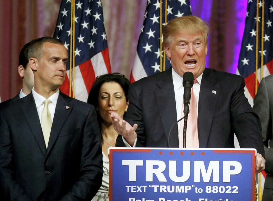 In this March 15 photo, Donald Trump's campaign manager Corey Lewandowski listens at left are Trump speaks in Palm Beach, Fla. Trump has fought to the cusp of the Republican presidential nomination with a small group of largely obscure operatives. Photo: The Associated Press  / Copyright 2016 The Associated Press. All rights reserved. This material may not be published, broadcast, rewritten or redistribu