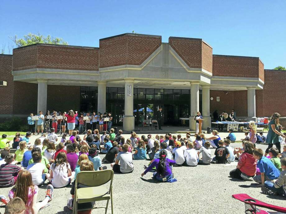 The Hinsdale School community gathered in Winsted to say farewell to the school when it was closed at the end of the school year. Photo: Ben Lambert — The Register Citizen