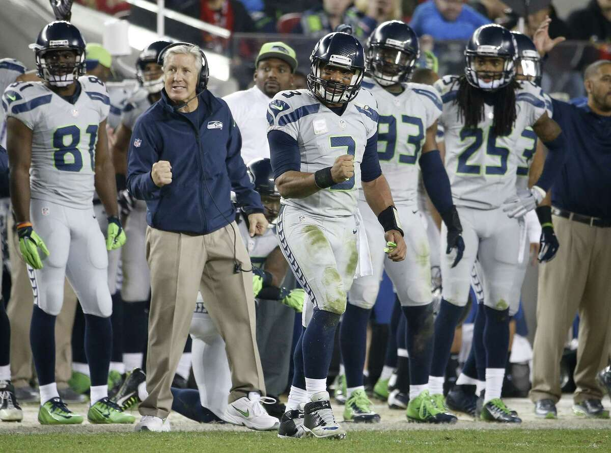 Head coach Pete Carroll, quarterback Russell Wilson (3) and the Seattle Seahawks will be the only home team and favorite to cover the spread in the divisional round of the NFL playoffs this weekend, according to the Register's Dan Nowak.