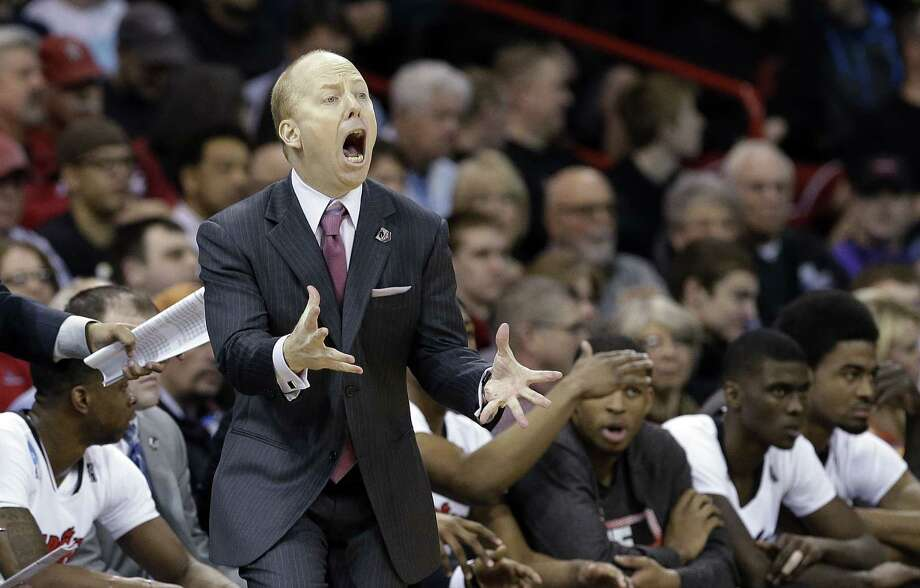 Cincinnati head coach Mick Cronin will not be on the sideline Saturday when the Bearcats play UConn at the XL Center. Photo: Elaine Thompson — The Associated Press File Photo  / AP