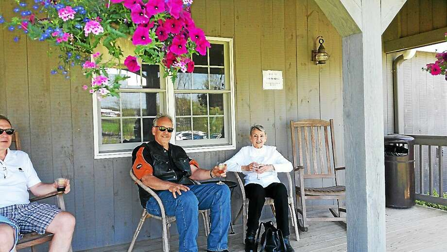 N.F. Ambery photo Visitors Mark Simiola and mother Nora Valery, both of Bristol, enjoy the porch at Sunset Meadow. Photo: Journal Register Co.