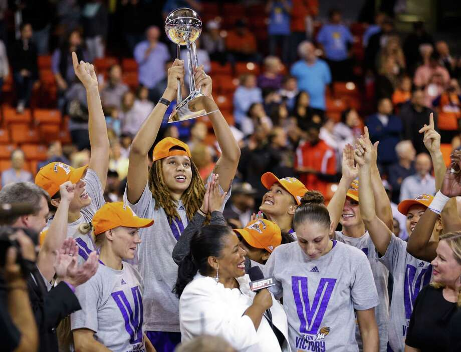 Phoenix Mercury center Brittney Griner (holding trophy) married fellow WNBA player Glory Johnson of the Tulsa Shock on Friday. Photo: Kamil Krzaczynski — The Associated Press File Photo  / FR136454 AP
