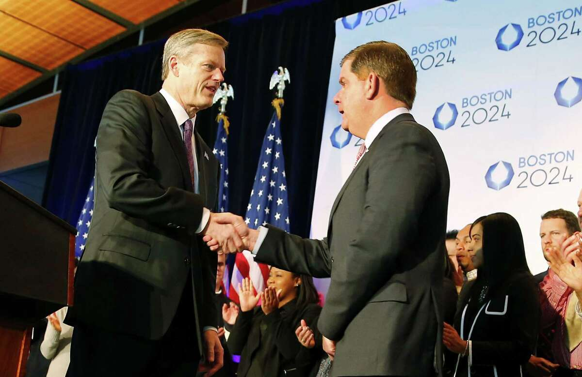 Massachusetts Gov. Charlie Baker, left, shakes hands with Boston Mayor Martin Walsh during a news conference in Boston Friday after the city was picked by the USOC as its bid city for the 2024 Olympic Summer Games.