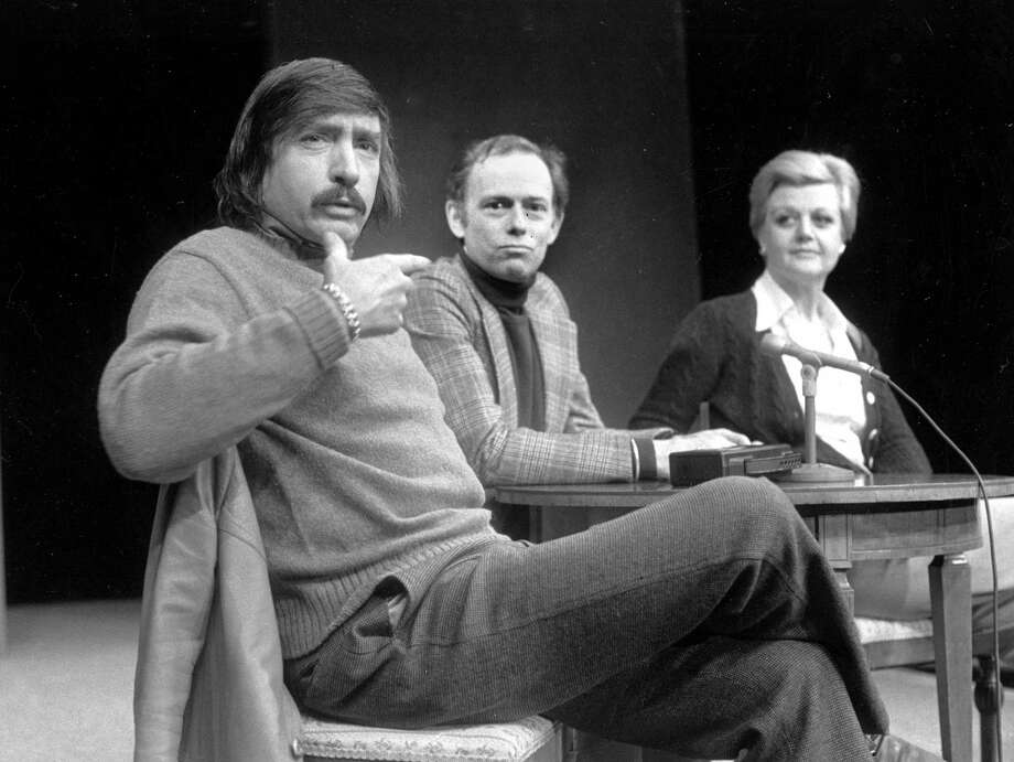 Playwright Edward Albee, left, makes a point as director Paul Weidner, center, and actress Angela Lansbury look on during a news conference in Hartford, Conn. Photo: The Associated Press FILE  / AP1977