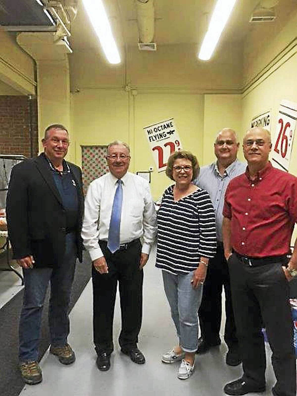 From left, Keith Risley, CEO; Owen Quinn, United Way executive director; Laurie McKenna, customer service rep; Steve Merhar, customer service manager; and Bob Lewis, general manager.