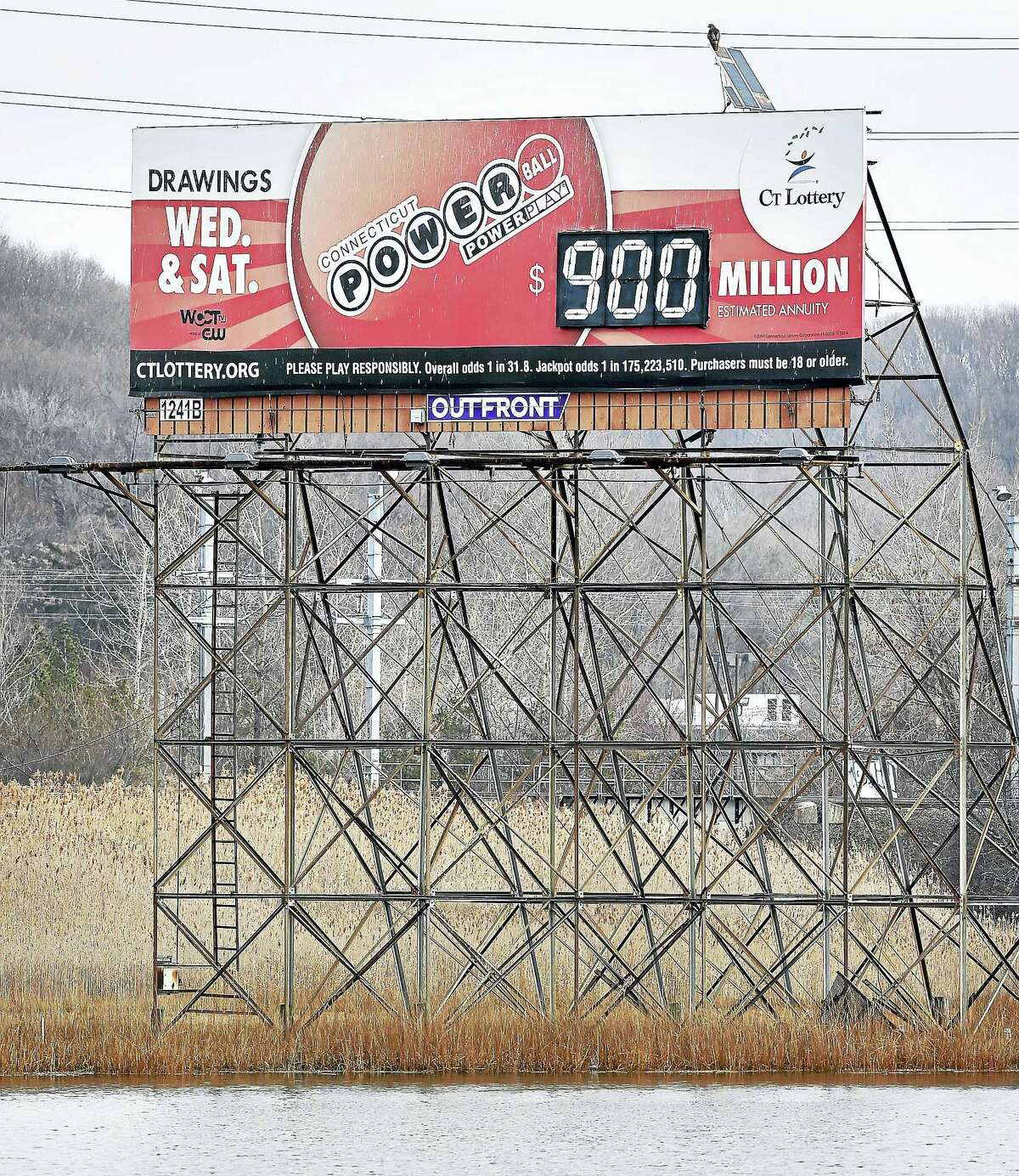 A Powerball sign overlooking the Quninnpiac River in New Haven reads 900 million as the jackpot for a drawing on 1/9/2016.