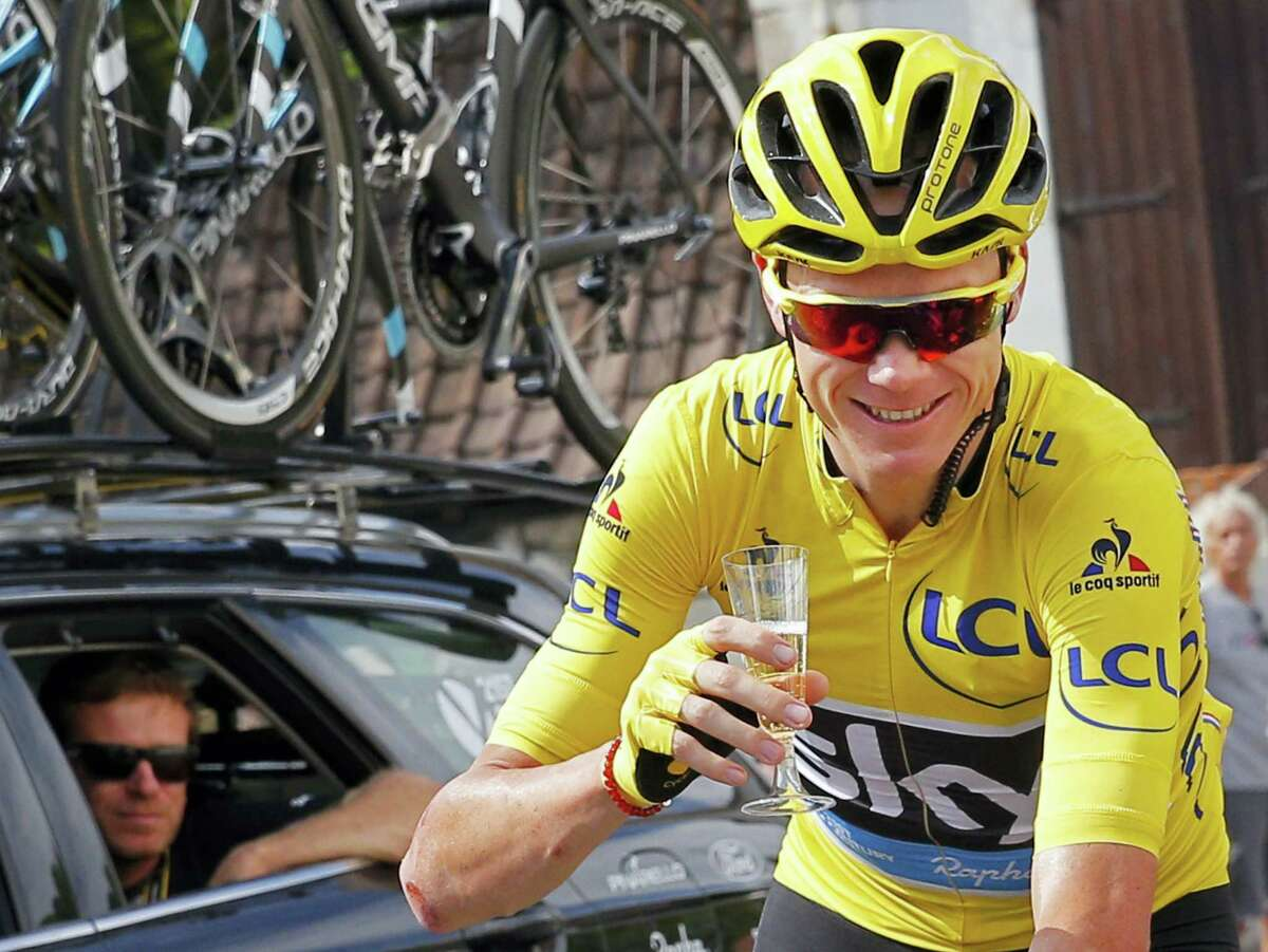 """This is a Sunday, July 24, 2016 photo of Britain's Chris Froome, wearing the overall leader's yellow jersey, celebrates with a glass of champagne during the twenty-first stage of the Tour de France in Paris. Three-time Tour de France winner Chris Froome said on Sept. 15, 2016 he has """"no issue"""" with his medical data being leaked, in an alleged criminal attack by Russian hackers on a World Anti-Doping Agency database."""