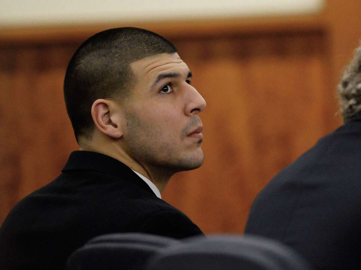 Former New England Patriots football player Aaron Hernandez attends a pretrial hearing in the first of two murder cases against him at Bristol County Superior Court in Fall River, Mass., on Tuesday, Jan. 6, 2015. Hernandez is charged with murder in the killing of semi-pro football player Odin Lloyd in 2013. He also is charged with killing two men in Boston in 2012. Hernandez has pleaded not guilty in both cases.