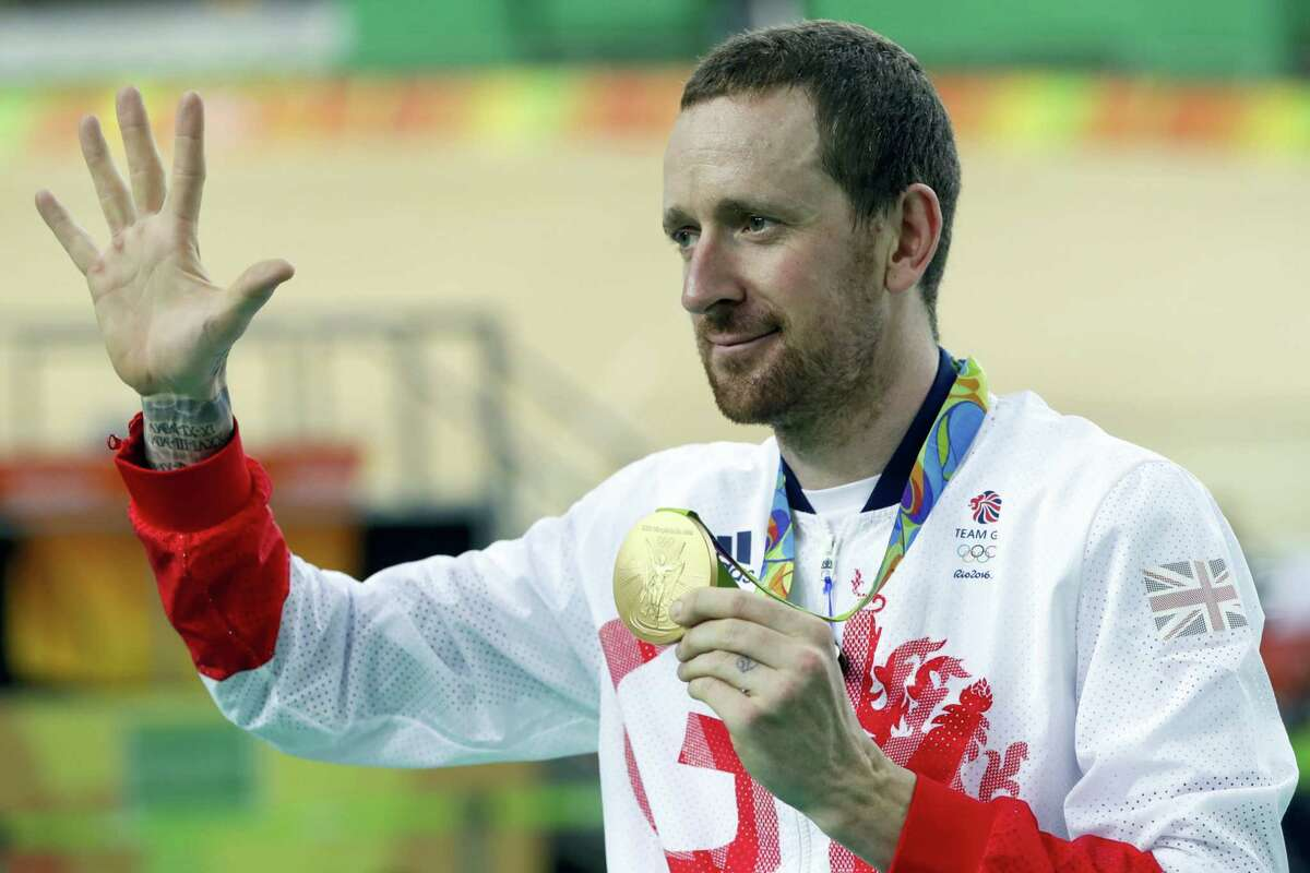 This is an Aug. 12, 2016 photo of Gold medalist Bradley Wiggins of Britain as he poses on the podium of the Men's team pursuit final at the Rio Olympic Velodrome during the 2016 Summer Olympics in Rio de Janeiro, Brazil. Medical data, in an alleged criminal attack by Russian hackers on a World Anti-Doping Agency database, leaked details of asthma medication used by Bradley Wiggins.