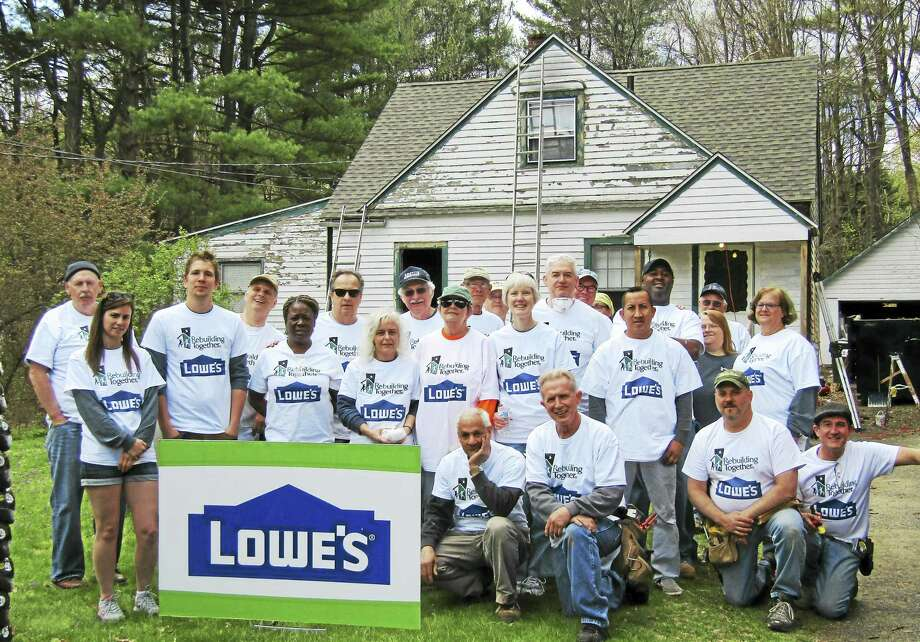 Contributed photoVolunteers with Rebuilding Together Litchfield County recently helped make energy-efficient improvements to Henrietta Reed's Northfield home. Photo: Journal Register Co.