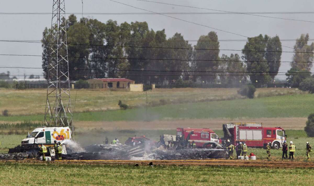 Emergency services personnel work in the area after a plane crash near the Seville airport, in Spain on May 9, 2015. A military transport plane crashed near southwestern Seville airport Saturday, killing its crew, Spain's prime minister said.