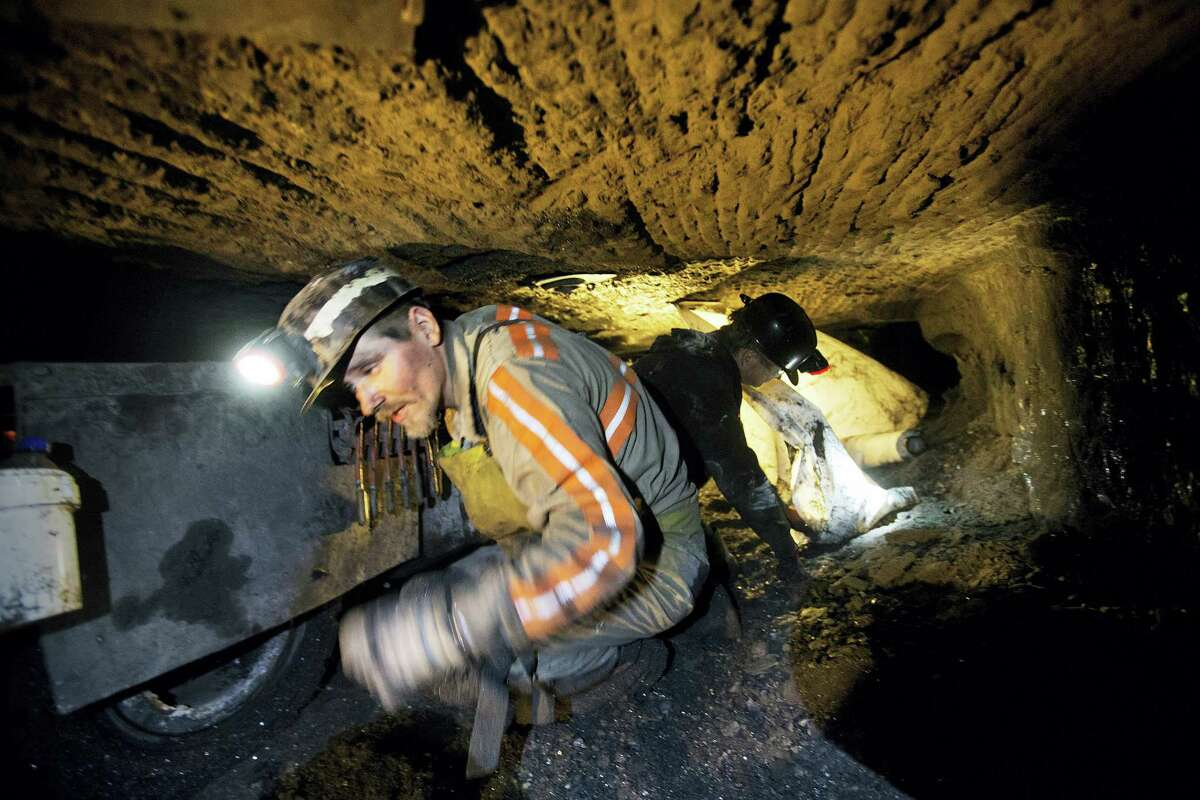 Scottie Stinson, a coal miner of 16 years, crawls through a coal mine roughly 40 inches high while securing the roof with bolts in Welch, W.Va. Coal will not go completely away anytime soon, it's the cheapest way to bring electricity to the 1.3 billion people who lack access to it, and even developed nations will still need to burn it as they transition to cleaner fuels. The carbon in coal will still be needed to mix with iron to make steel. But there is so much more coal than the world needs that only the cheapest global producers will survive.