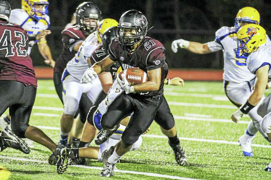 Photo by Marianne Killackey Torrington's Dom Phengkaen burst 55 yards for a touchdown against Seymour before the Wildcats found their stride. Photo: Journal Register Co. / 2015
