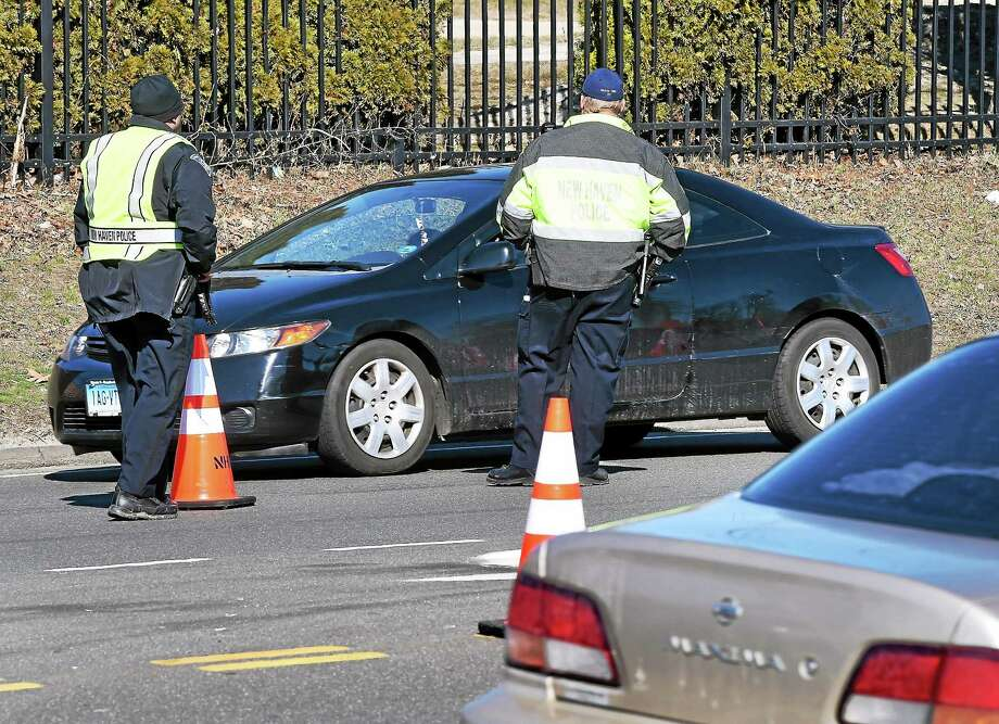 Police look for drivers using their cellphones at a checkpoint on Route 80 in New Haven April 1. Photo: Arnold Gold — New Haven Register