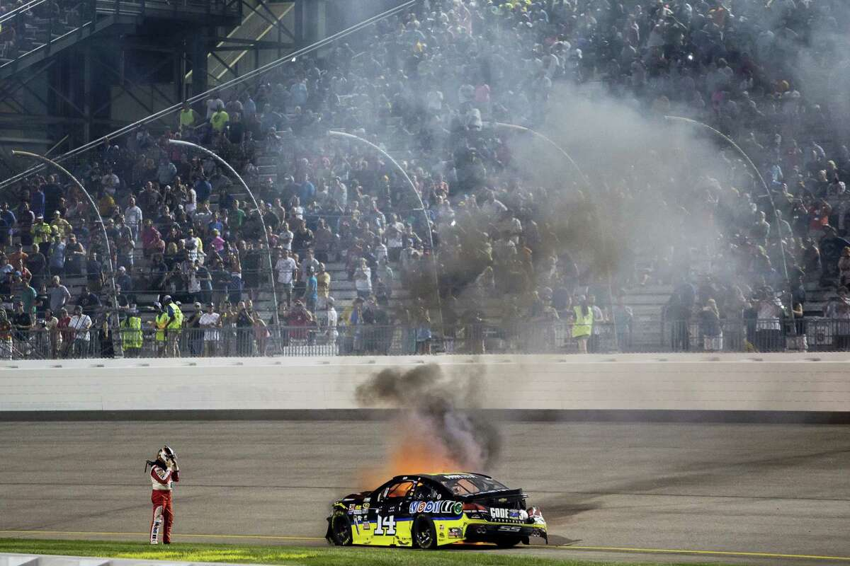 Tony Stewart watches his car burn after crashing during Saturday's race at Richmond International Raceway.