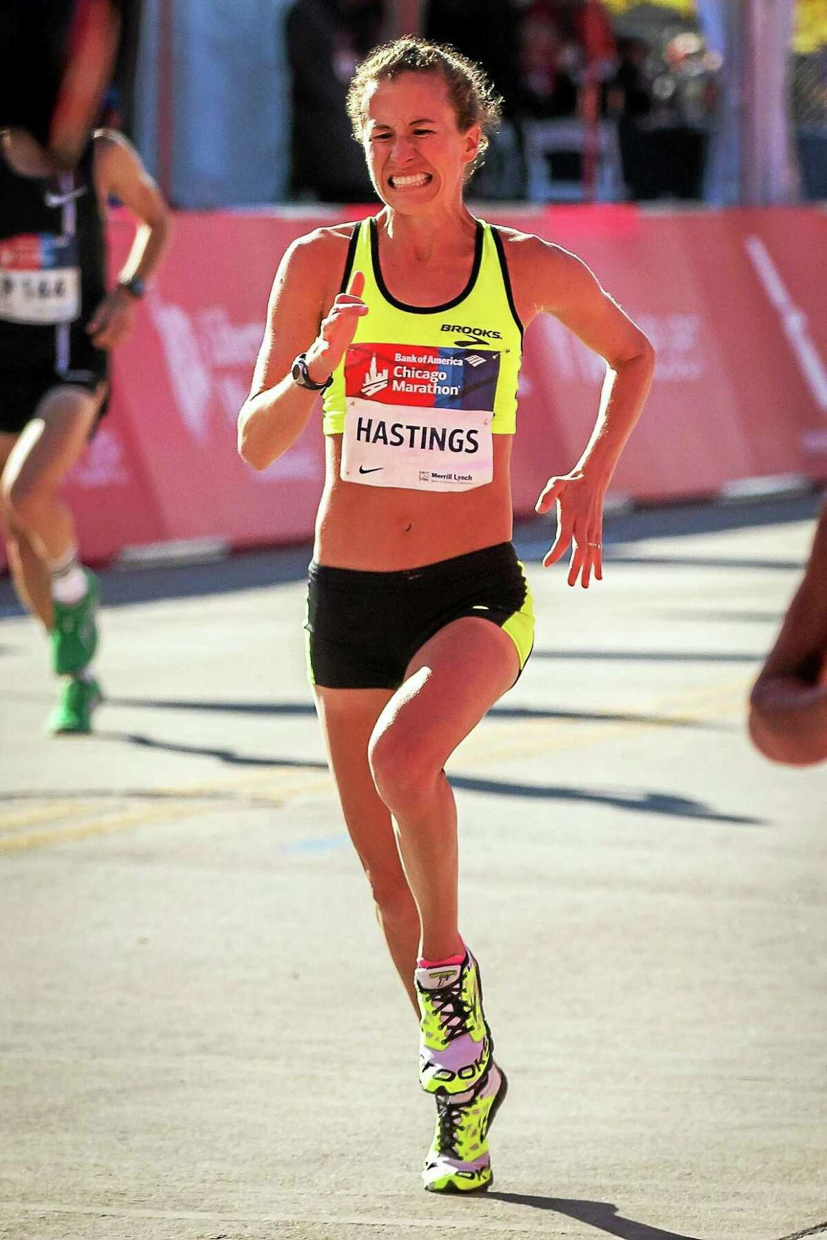 Amy Hastings crosses the finish line at last October's Chicago Marathon. Hastings finished fifth.