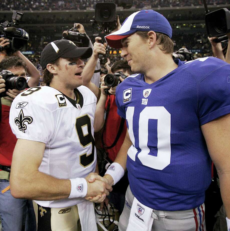 Saints quarterback Drew Brees, left, and Giants quarterback Eli Manning shake hands. Photo: The Associated Press File Photo  / AP2009