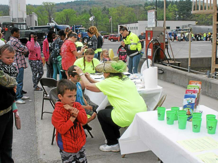 Dozens of people in Torrington enjoy the Touch-A-truck event to mark safety week. Photo: Stephen Underwood - Register Citizen