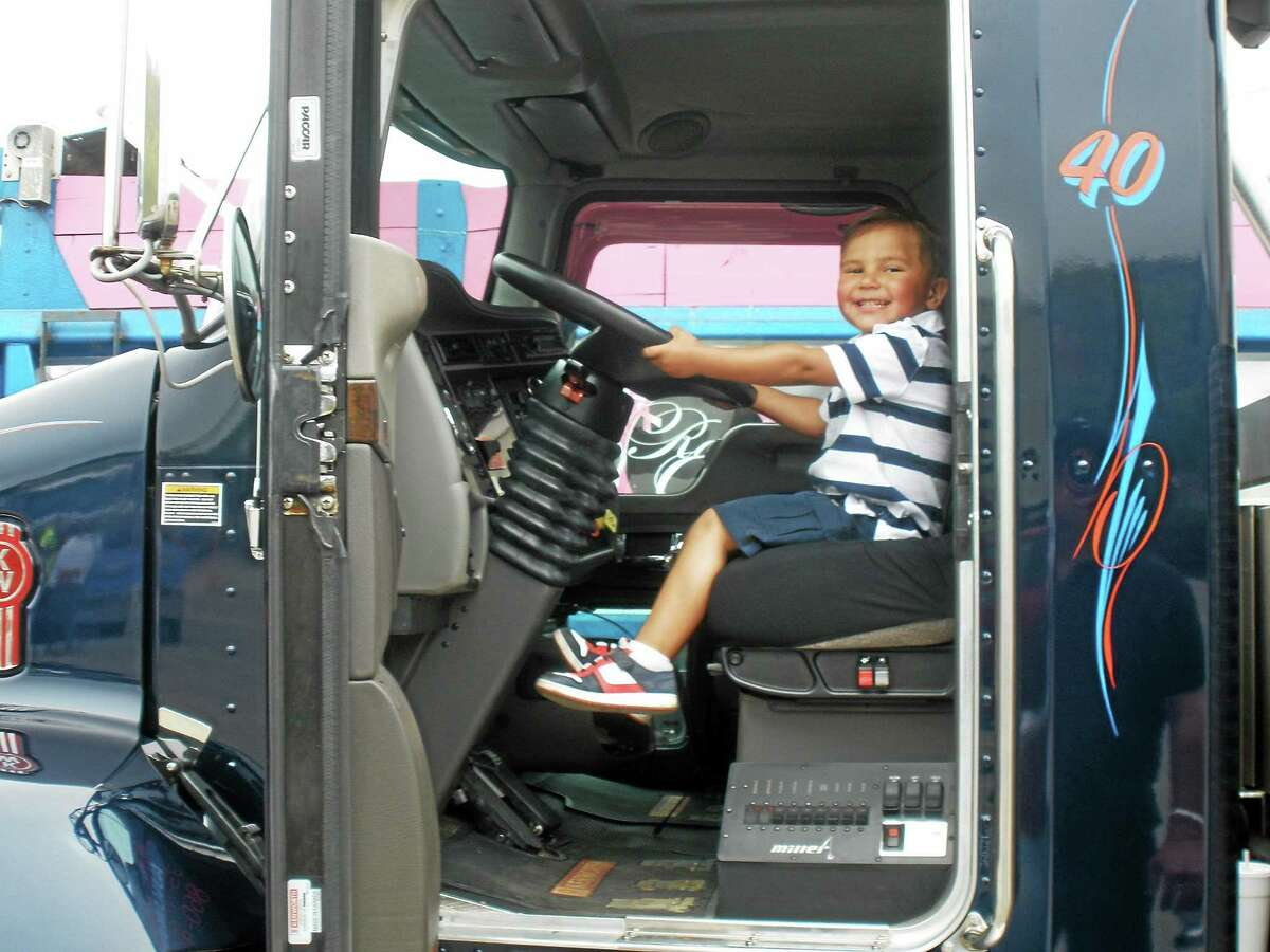 Jayden Matos, 3, behind the wheel of a semi-truck at the Touch-a-Truck event on Saturday.