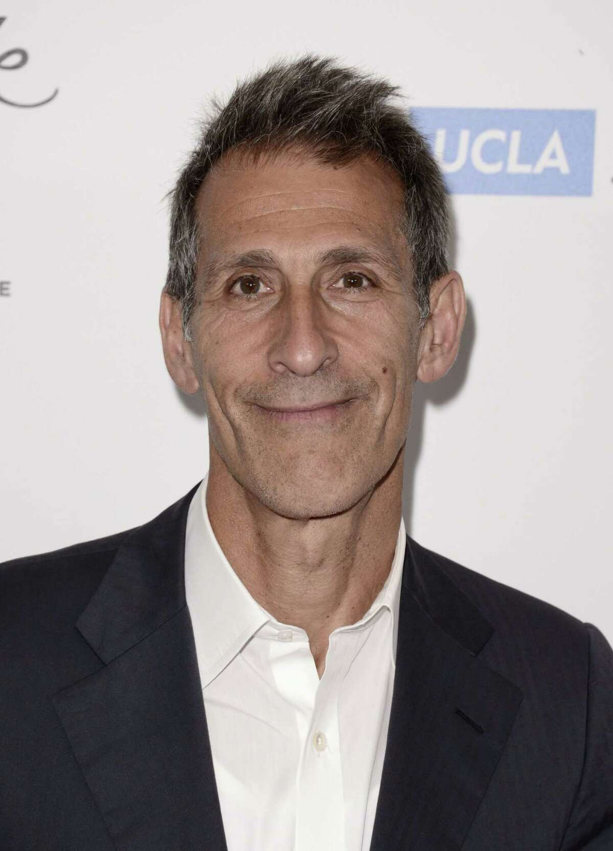 """FILE - In this April 25, 2014 file photo, Michael Lynton, chairman and CEO, Sony Pictures Entertainment, arrives at the 19th annual """"Taste For A Cure"""" at the Beverly Wilshire Hotel, in Beverly Hills, Calif. More than six weeks after hackers attacked Sony Pictures Entertainment, its computer network is still down but the studio has not lost a single day of production on any of its films or television, Lynton told The Associated Press on Thursday, Jan. 8, 2015. In a wide-ranging interview Lynton talked about the companyís isolation and the uncertainty that was created by the pre-Thanksgiving attack, which the U.S. government has attributed to North Korea. (Photo by Dan Steinberg/Invision/AP, File)"""