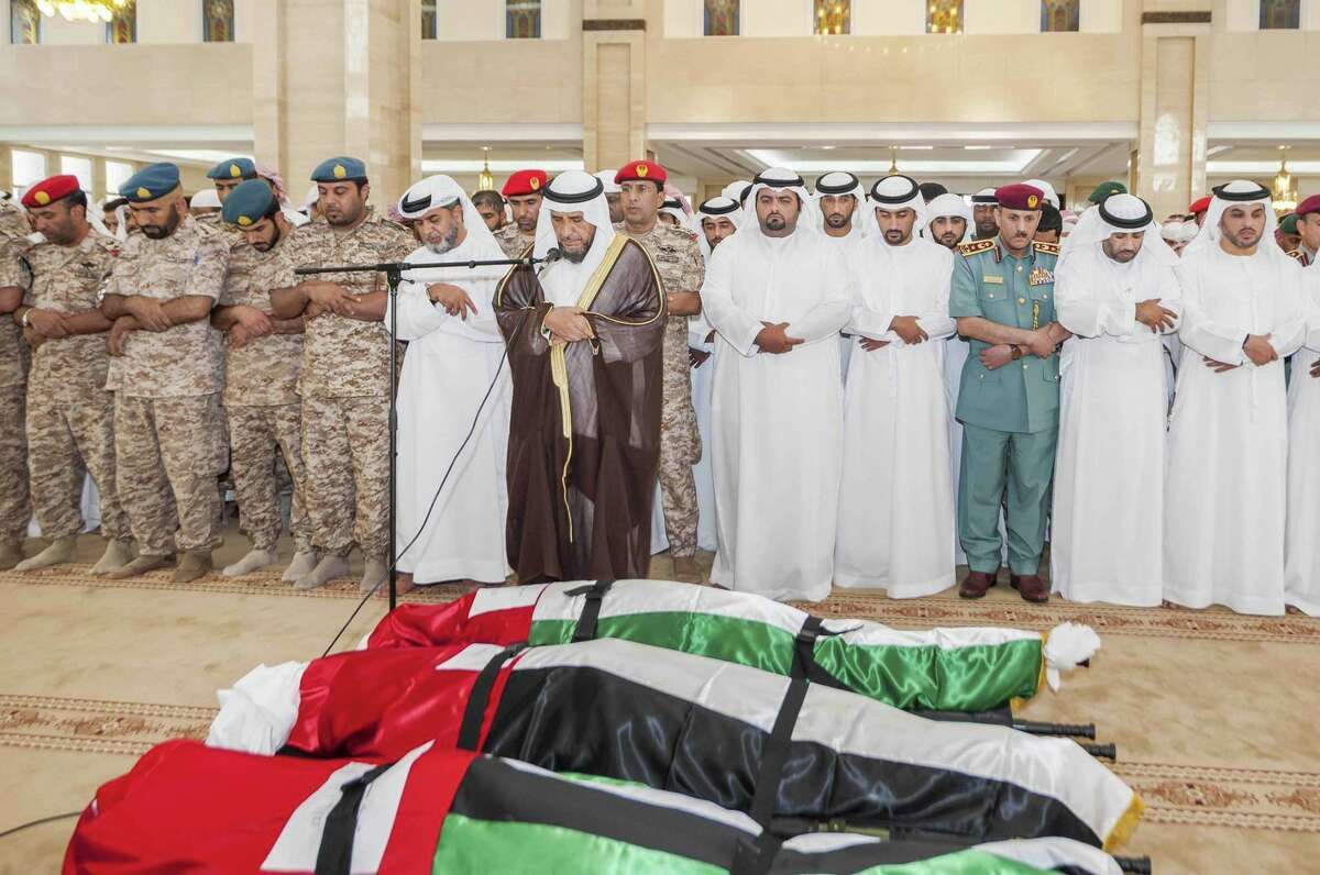 In this photo made available by Emirates News Agency, WAM, Emiratis perform prayers over the bodies of soldiers who were killed in Yemen during their funeral ceremony in Fujairah, United Arab Emirates, Saturday, Sept. 5, 2015. Forty-five troops from the United Arab Emirates were killed in Yemen when rebels hit an ammunition depot in Marib, about 120 kilometers (75 miles) east of the capital Sanaa, the Gulf nation said Friday, in the deadliest day for its military in its 44-year history. A Saudi military spokesman said Saturday that 10 of its nation's troops were also killed in the rebel missile strike, in the first public acknowledgement by the Saudis that they have ground troops in Yemen.